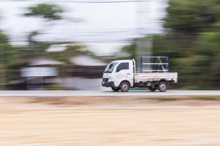 panning: Mini truck panning camera in road