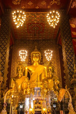 hariphunchai: Buddha statue in Wat Phra That Hariphunchai, Lamphun province, north of Thailand Editorial