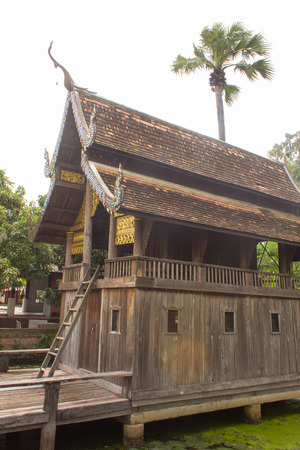 old thai wood chapel in temple lanna style