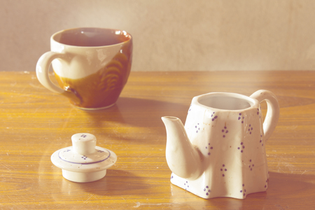 still life classic ceramic kettle with cup