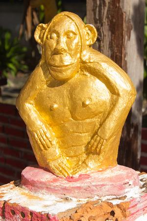 animal figurines: Golden monkey statue in thai temole