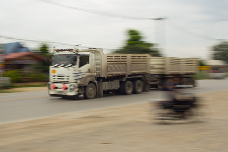 panning: truck panning camera in road