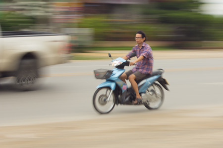 motorcycling: Motorcycling Panning on road In Thailand