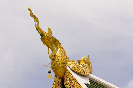 apex: Golden Hussadeeling Statues gable apex with sky Stock Photo