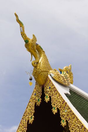 himmapan: Golden Hussadeeling Statues gable apex with sky Stock Photo
