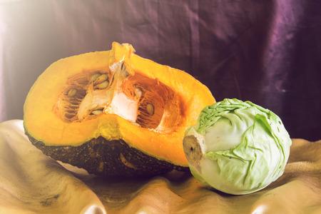 still life split pumpkin and cabbage