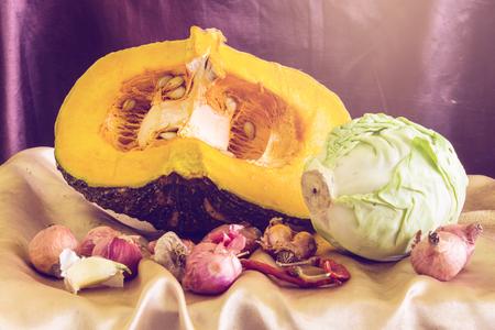 dried gourd: still life split pumpkin, shallots, garlic, dried chilli and cabbage