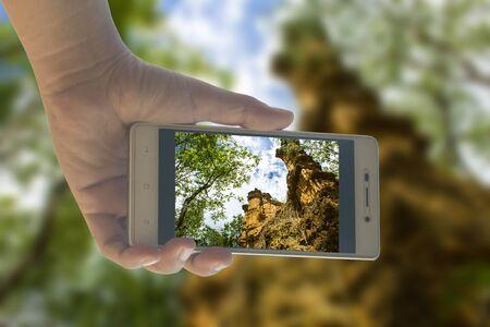 grand hard: People use mobile phone photograph phachor in Doi Lo  Chiangmai , Grand Canyon National Park, Thailand Stock Photo