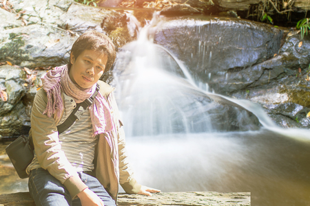 north cascade national park: Asian man lonely at Mon Tha Than Waterfall in Doi Suthep - Pui National Park, Chiang Mai  Thailand Stock Photo