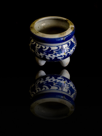 snuff: Old incense burner Ceramic isolated on black with reflection