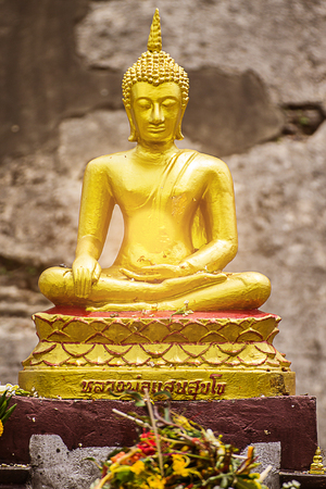 mit: golden thai buddha statue with light