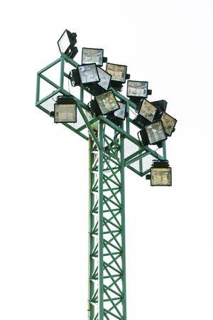 spot lit: Big spotlights lighting tower Isolated Stock Photo