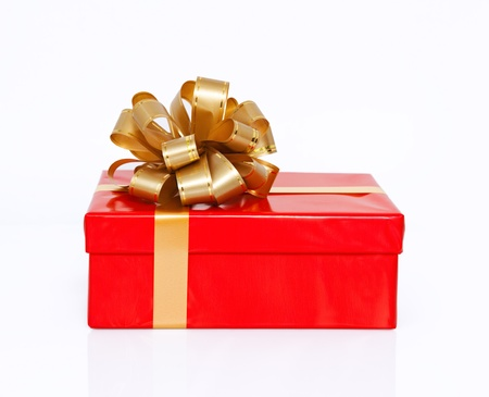 Isolated red gift box with a gold bow on New Year holiday photo