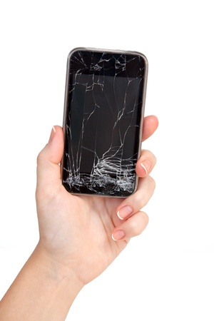 cracked: broken phone in a female hand