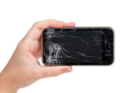 vidrio roto: teléfono roto en una mano femenina Foto de archivo