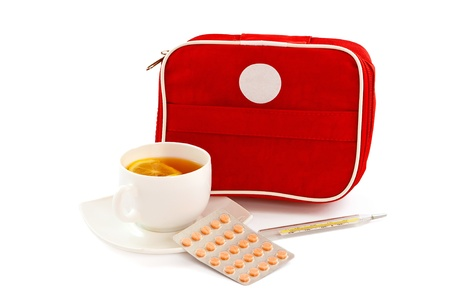 firstaid: Image with first-aid kit, pills and a cup of tea