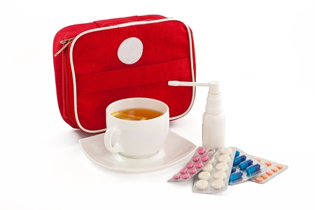 firstaid: The image of the first-aid set, cup of tea with a lemon, tablets and an inhaler Stock Photo