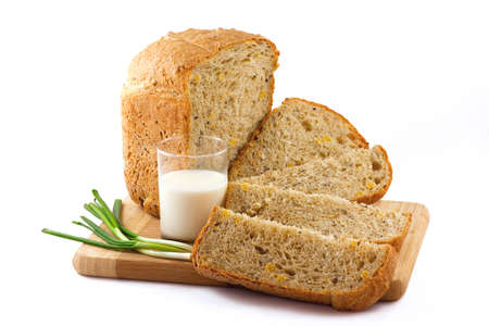 french bread: isolated image loaf of bread, a glass of milk and leek