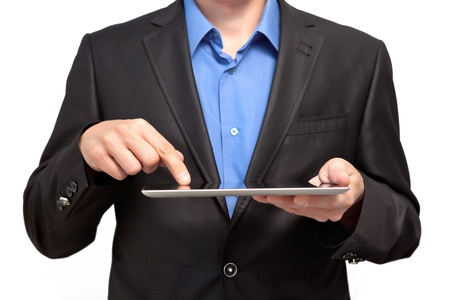 Businessman holding a tablet and touches the screen photo