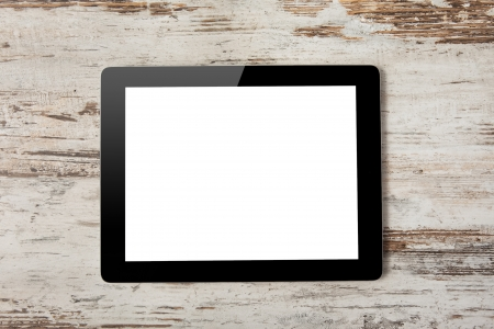 Tablet computer with isolated screen on a background of wood photo