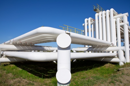 Industrial pipe with gas and oil and water on a background of blue sky photo