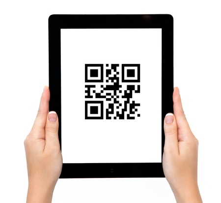 female hands holding a tablet with qr code Stock Photo - 18058148