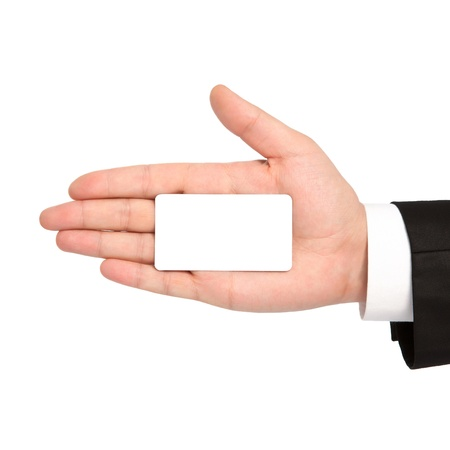 isolated hand of a businessman in a suit holding a white business card photo