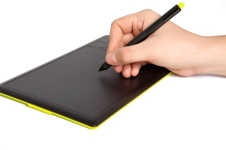 isolated mans hand draws a pen on a touch tablet photo