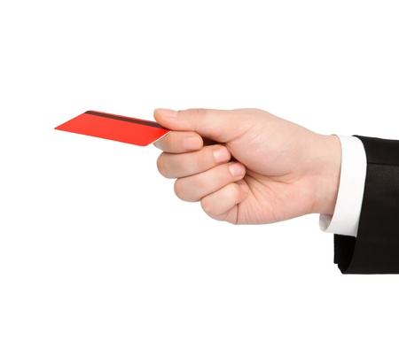 isolated hand of a businessman in a suit holding a red credit card photo
