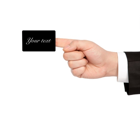 isolated hand of a businessman in a suit holding a black business card photo