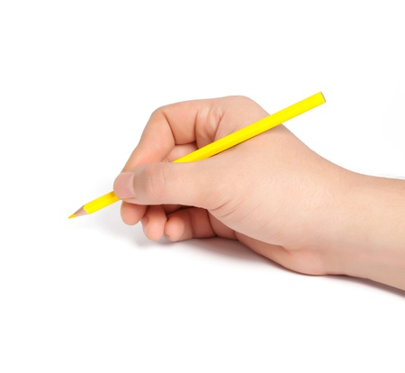 isolated man hand holding a yellow pencil and something draws or writes Stock Photo - 18132668