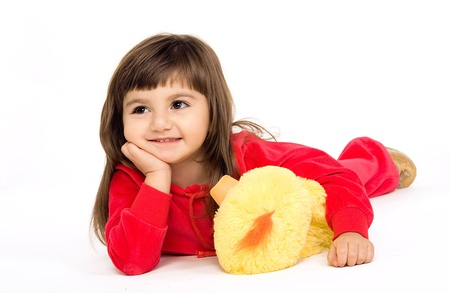The little girl plays with a soft toy Stock Photo - 18178620