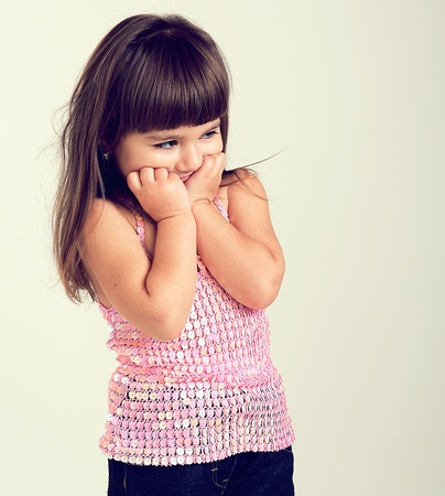 insult: The small offended girl Stock Photo