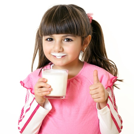 children breakfast: Beautiful little girl with a glass of milk