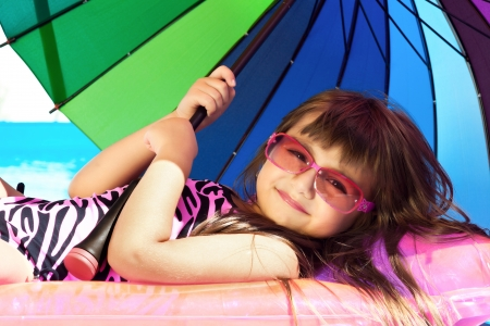 little girl on a pink mattress with a swimming pool Stock Photo - 18178621