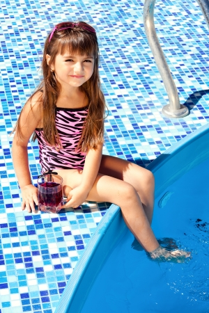 little girl on a pink mattress with a swimming pool Stock Photo - 18178616