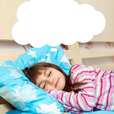 little girl asleep in her bed and dreams Stock Photo