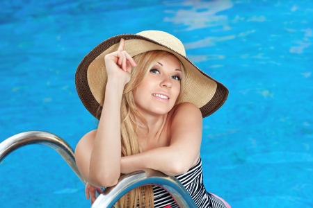 beautiful girl in the hat in the pool Stock Photo - 18380780
