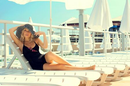 The beautiful woman has a rest on the yacht Stock Photo - 18380811