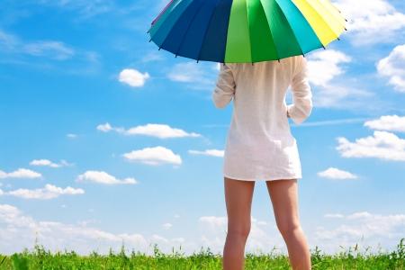 sun umbrella: sexy girl in a field with a bright umbrella