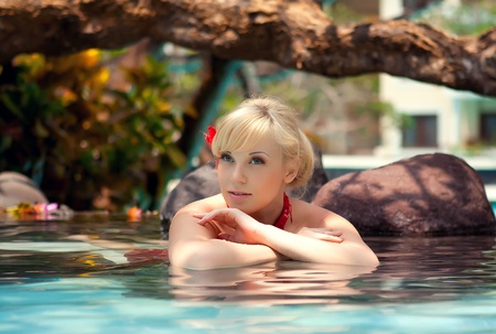 day spa: Series the beautiful girl lies in water with flowers