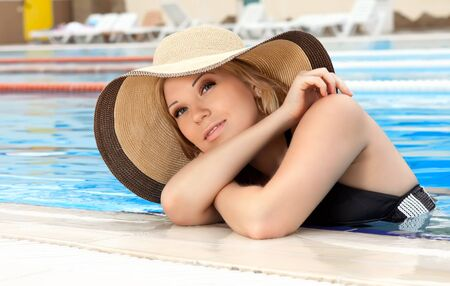 series closeup portrait the smart blonde in a hat in pool of expensive hotel Stock Photo - 18572087