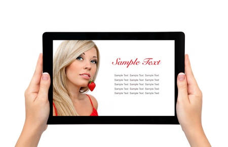 isolated female hands hold longer banner computer tablet with a beautiful blonde sexy girl and a strawberry on the screen photo