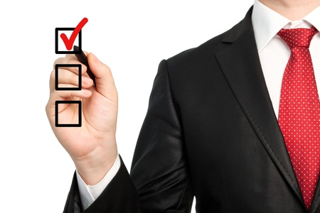 red pen: Isolated businessman in a suit with a red tie holding a pen and writing red check mark or make a choice Stock Photo