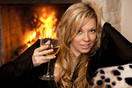 beautiful girl by the fireplace in the winter night Stock Photo - 18572070