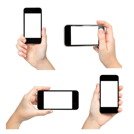 with phone: Isolated female hands holding the phone in different ways Stock Photo
