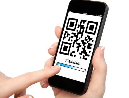 scanning: woman hand holding a phone with qr code on the screen with a blue stripe scanning Stock Photo