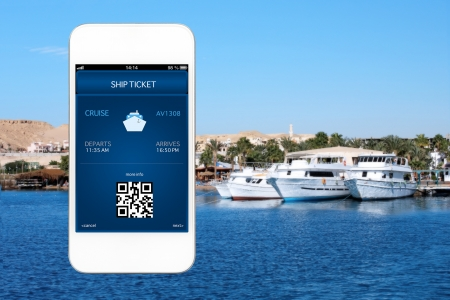 white phone with mobile wallet and liner ticket against the background of the sea with yachts photo