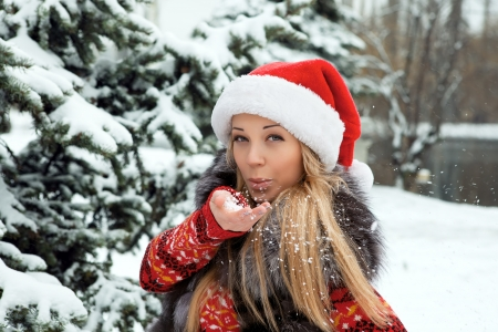 beautiful girl in the new year near Christmas tree with snow photo