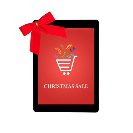 tablet touch computer gadget with red gift bow and christmas sale on a screen photo